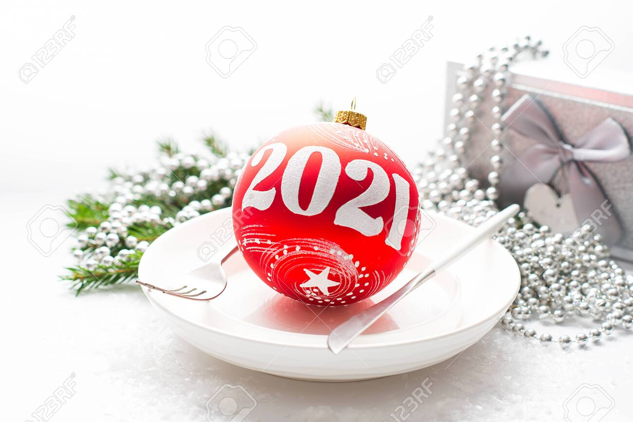 2021 Christmas White Background Christmas Composition With A Gift Red Christmas Ball On A White Stock Photo Picture And Royalty Free Image Image 156796407