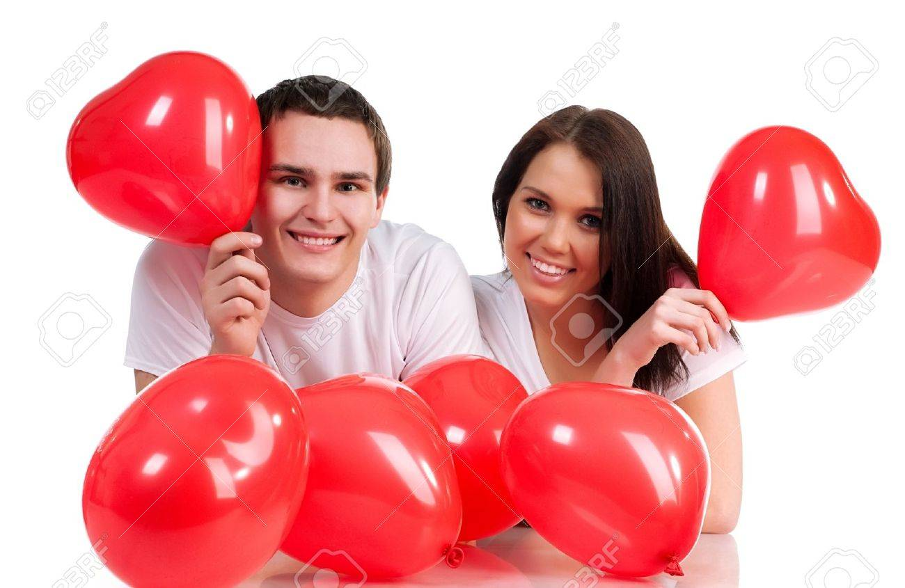 Couple with a red heart on white background Stock Photo - 8689791
