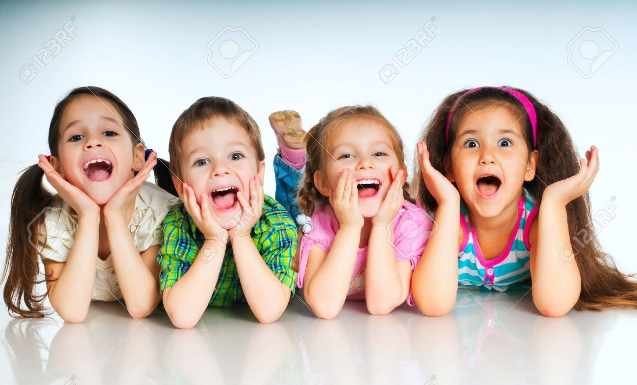 Laughing Small Kids On A White Background Stock Photo Picture And