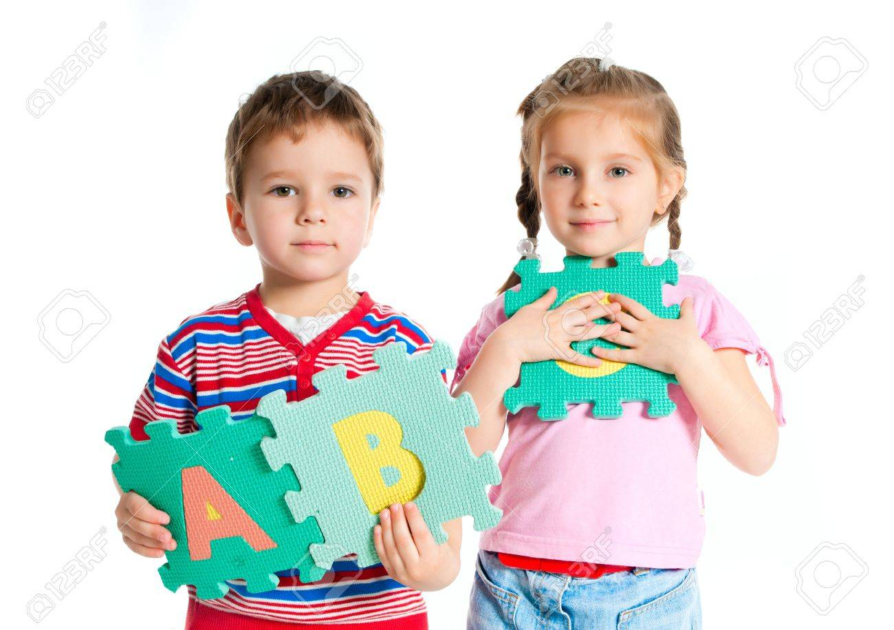 boy and girl are holding colorful letters Stock Photo - 9780517