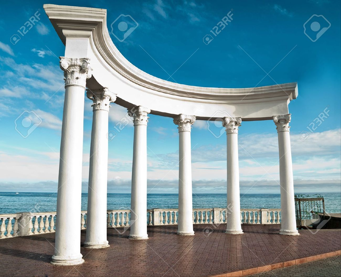 Greek Architecture Columns ancient greek columns against a blue sky and sea stock photo