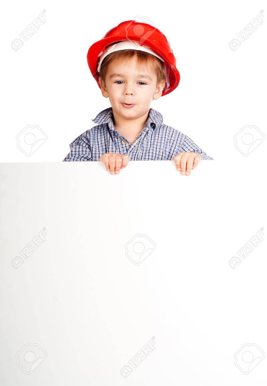 little boy wearing a helmet against white banner Stock Photo - 12942407