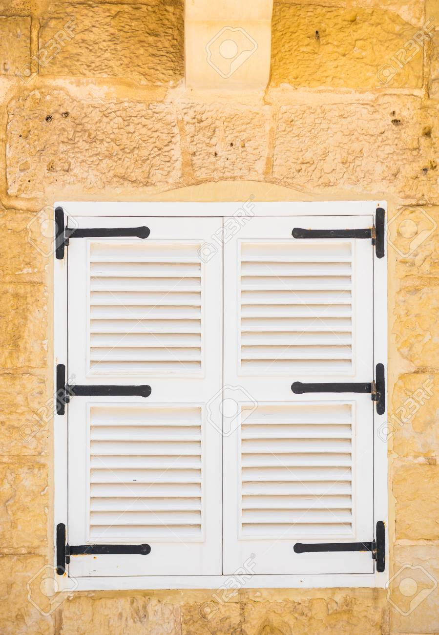 White Wooden Window Shutters With Black Details
