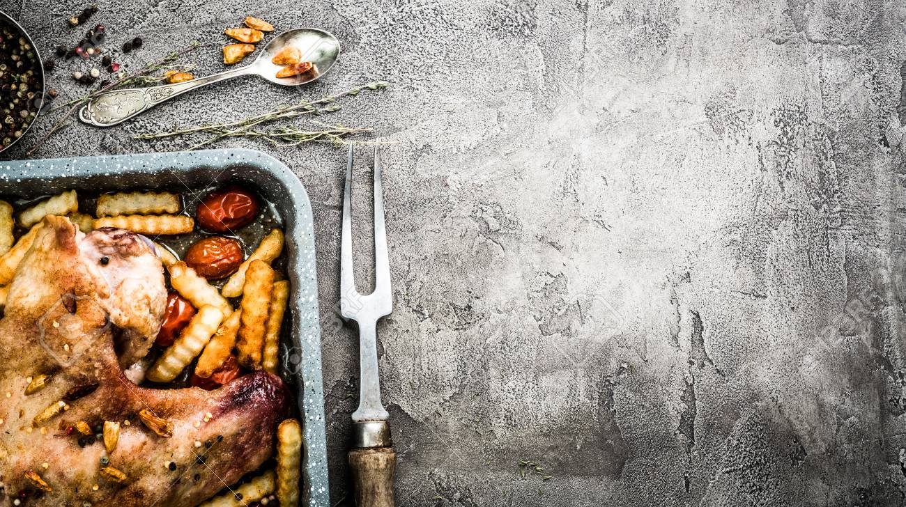 Homemade turkey wing with french potatoes in baking tray with