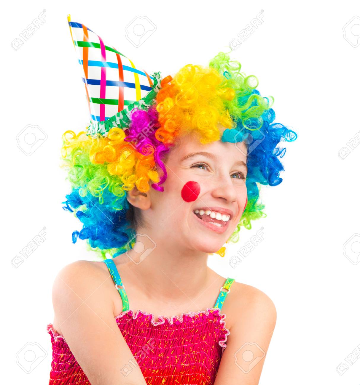Funny little girl in clown wig with red spots on her cheeks isolated