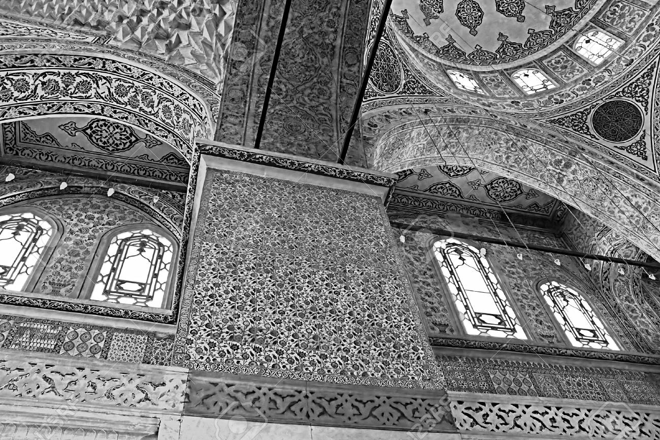 Inside the islamic blue mosque istanbul turkey black and white filter stock photo