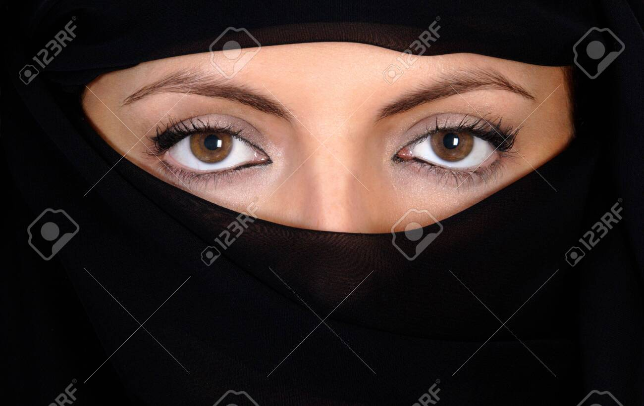 Beautiful eyes looking from above her veil Stock Photo - 613509