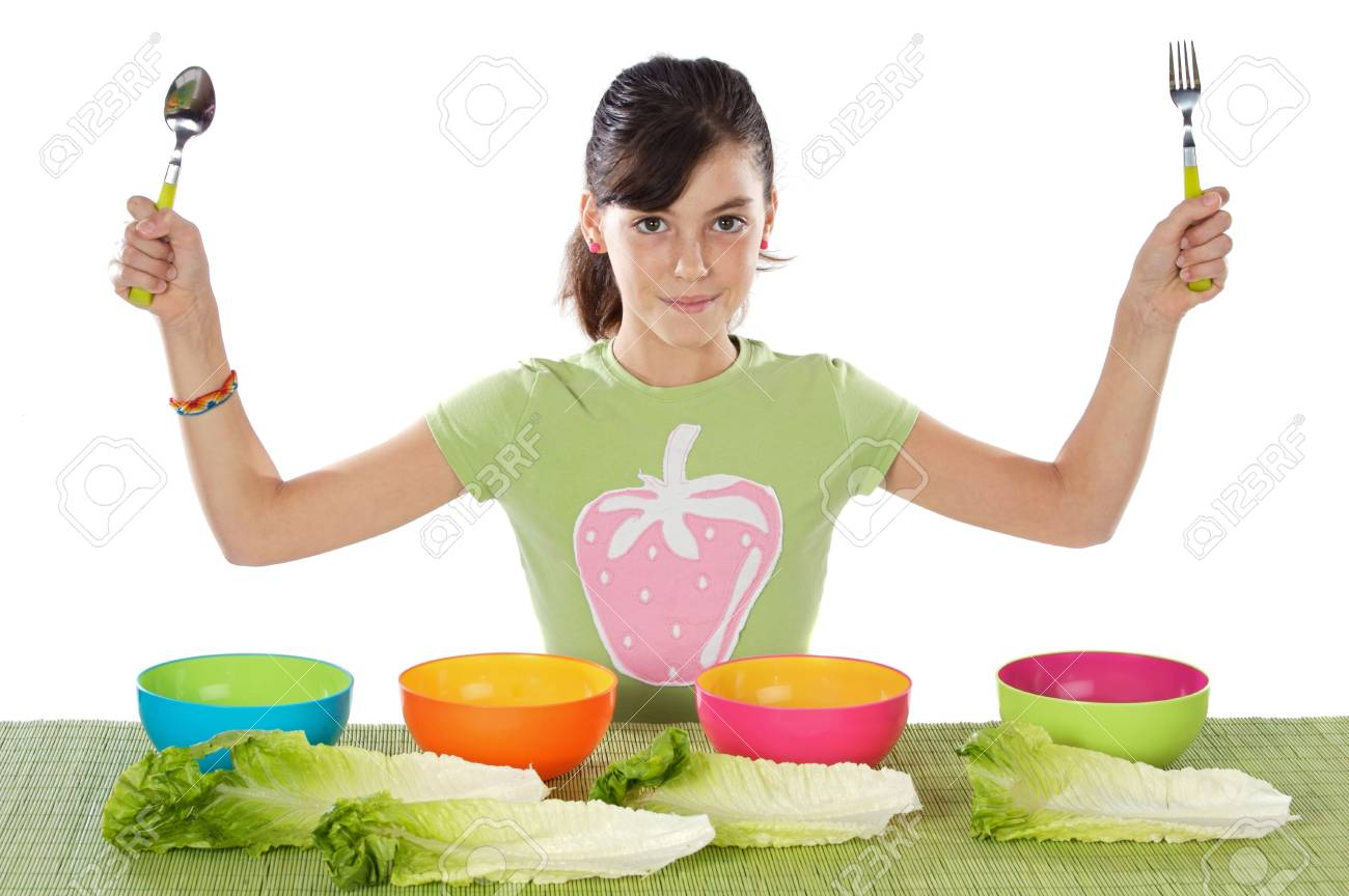 Cute young girl with lettuce and colourful bowls Stock Photo - 2032353
