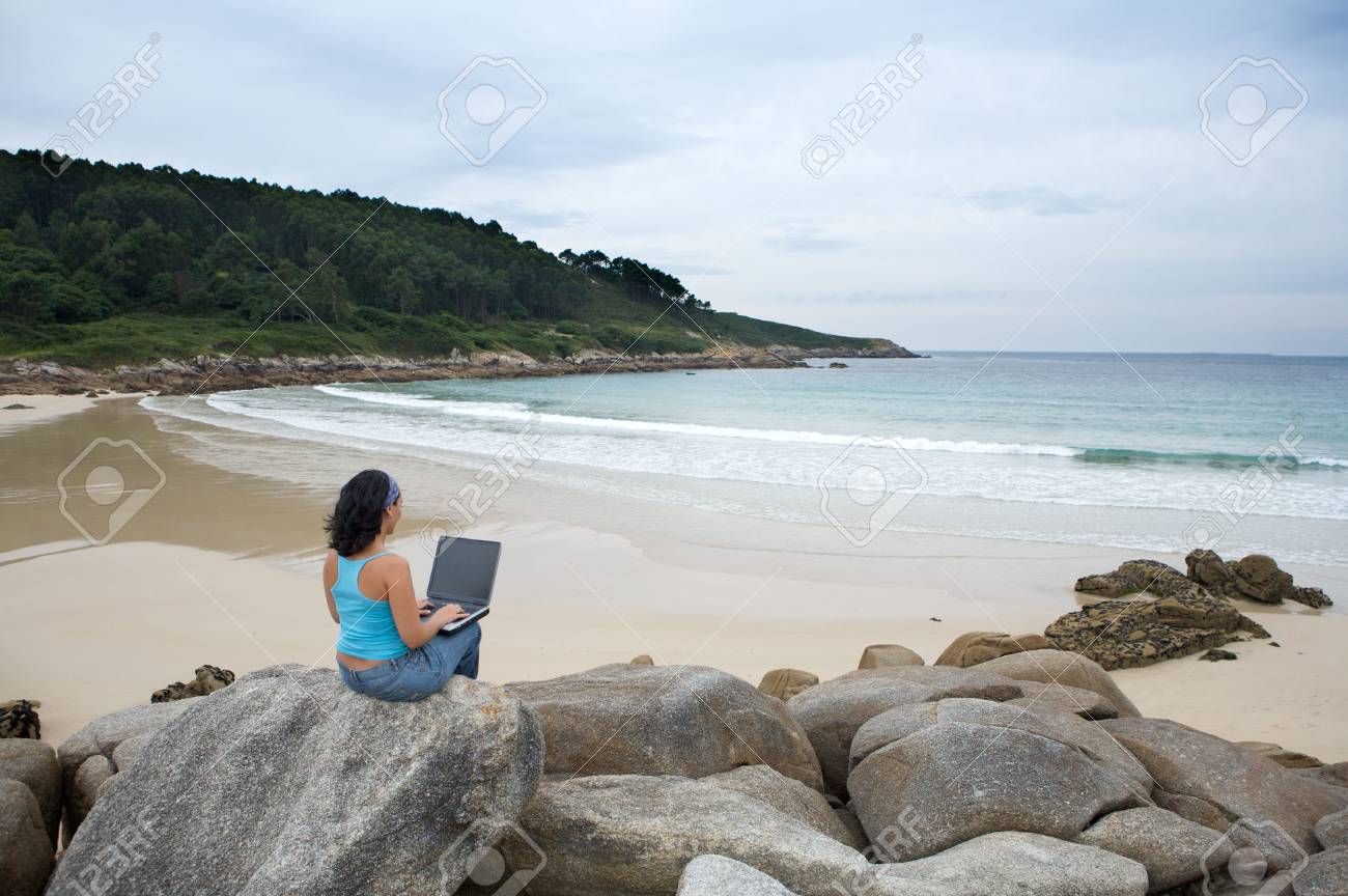 woman with laptop computer on the beach Stock Photo - 3452256