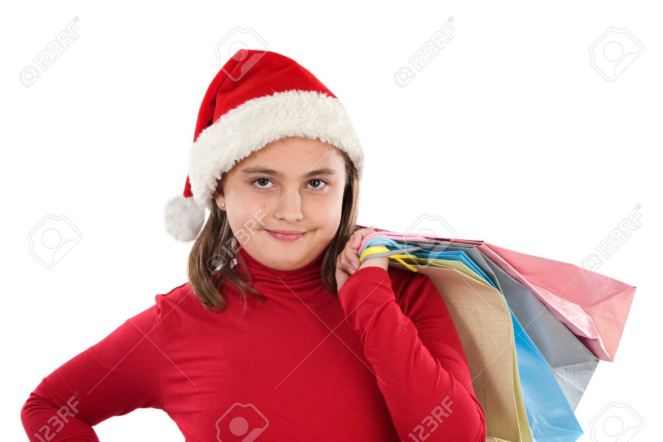Beautiful girl with hat of christmas and bags on a over white background Stock Photo - 3988750