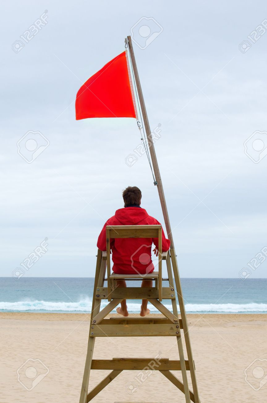 Lifeguard chair cartoon - Lifeguard Chair Lifeguard Sitting In His Chair Watching The Sea Stock Photo