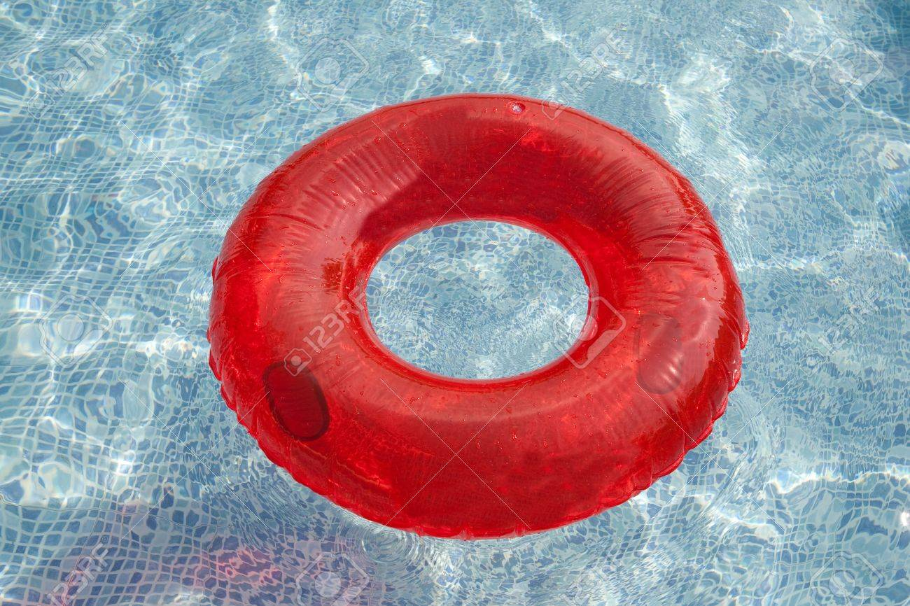 Red float floating in the pool with blue water Stock Photo - 5569290
