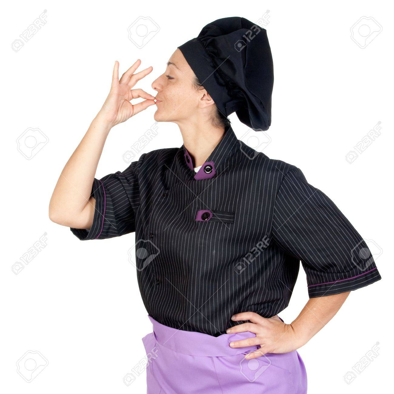 Pretty cook woman with black uniform isolated on white background Stock Photo - 6121739