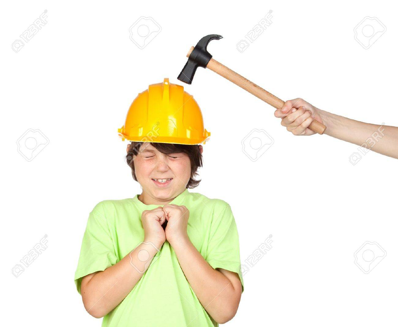 Frightened child with yellow helmet and hammer over a white background Stock Photo - 7271840