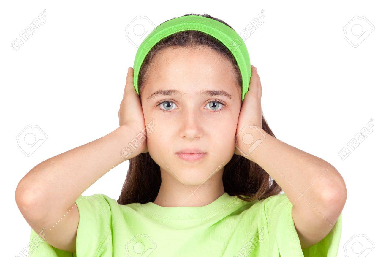 Frightened girl with ears plugged isolated on a white background - 7363443