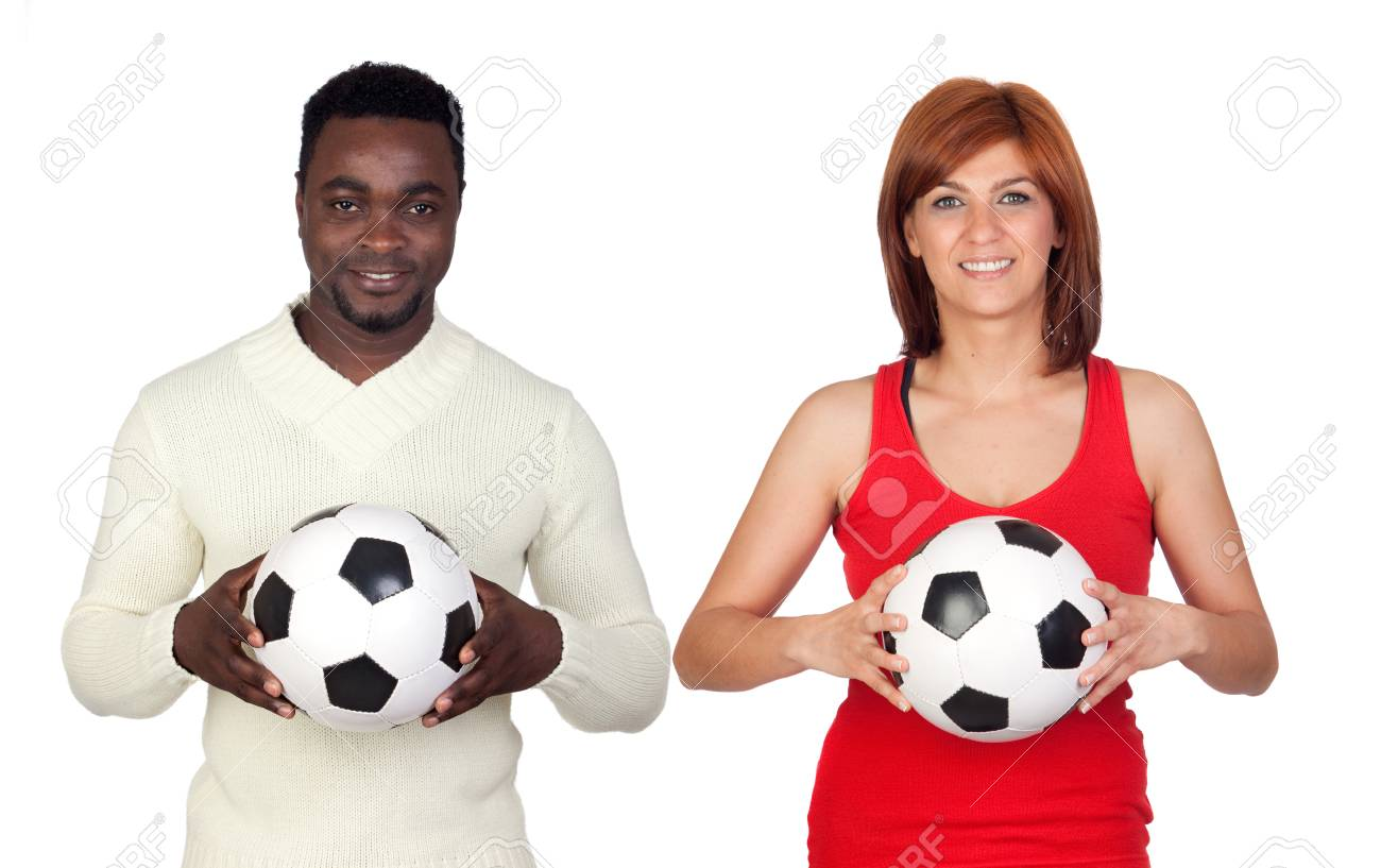 Beautiful redhead girl and attractive african men with a soccer ball isolated on a over white background Stock Photo - 12373823