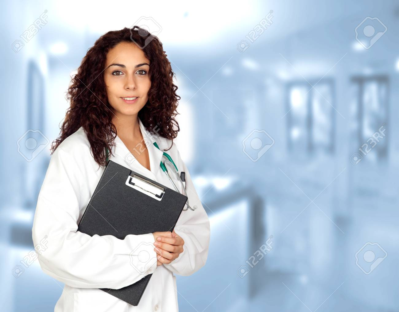 Brunette spanish doctor woman with a clipboard in the hospital
