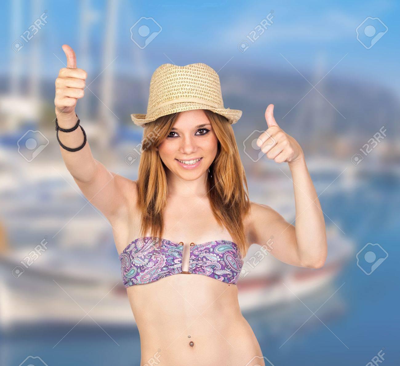 Young Casual Girl with Bikini in Summer Holiday Saying Ok Stock Photo - 17237284