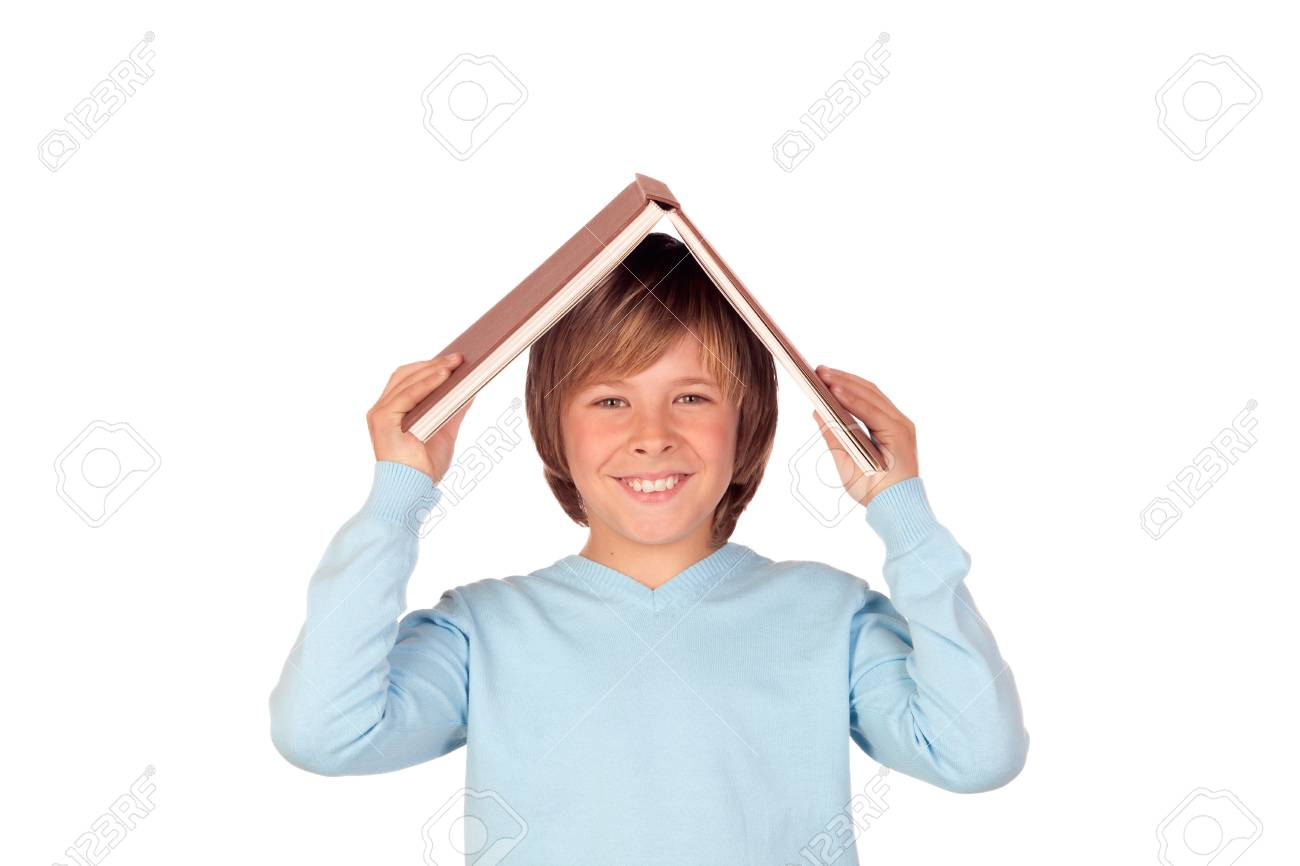 Preteen boy with a big book oh his head isolated on white background Stock Photo - 18522247