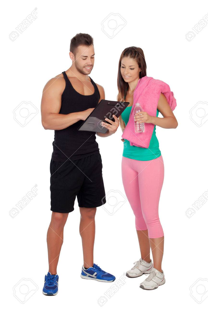 Handsome personal trainer with a attractive girl isolated on a white background - 22221648