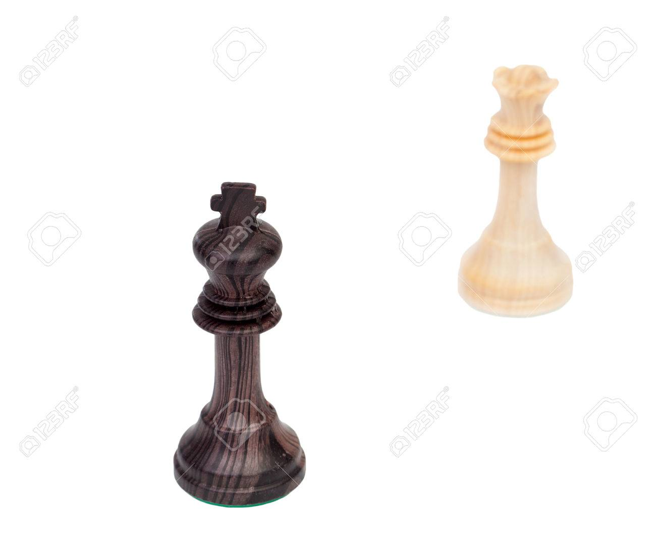 The King And Queen Faced Wooden Chess Pieces Isolated On A White