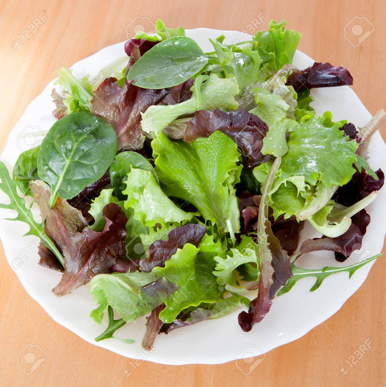 Delicious Salad Of Different Types Of Lettuce Leaves Dressed