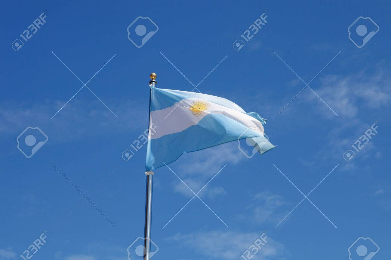Argentina Flag Waving In The Mast With Blue Sky Background Stock