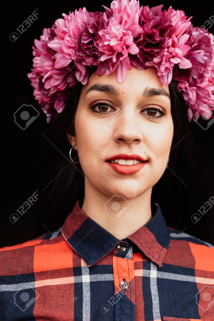 Pretty girl with pink flower crown in her head and a black pretty girl with pink flower crown in her head and a black background stock photo izmirmasajfo