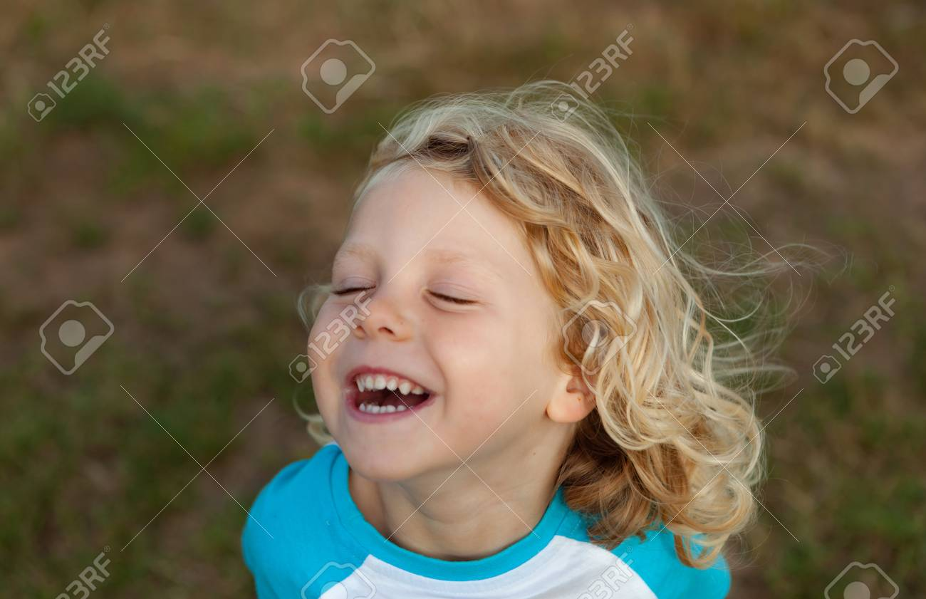 Small child with long blond hair enjoying of a sunny day - 86359634