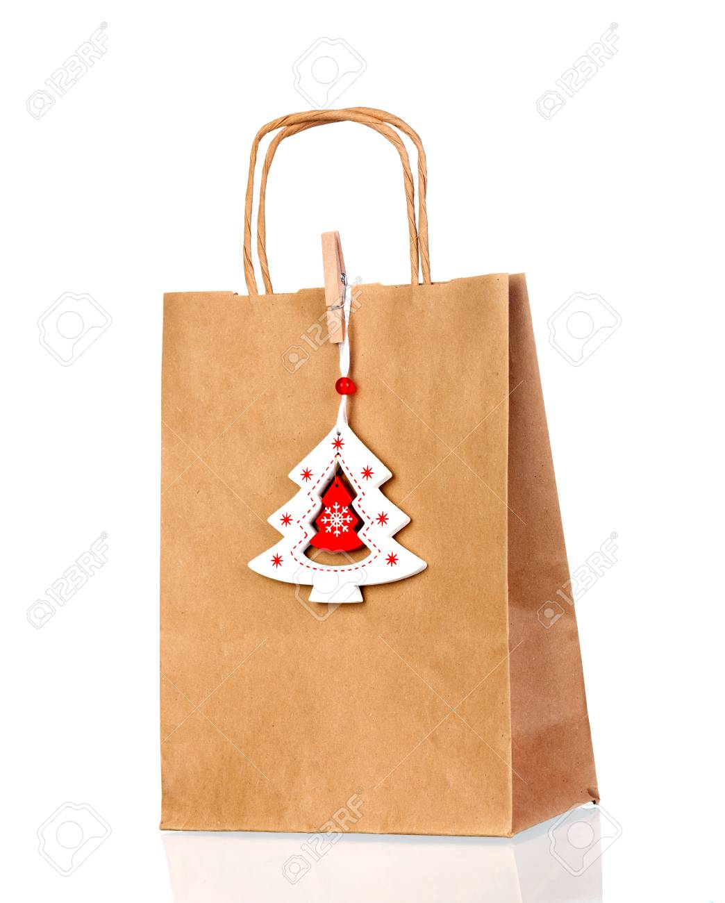 Brown Paper Bag With Christmas Decoration Isolated On A White