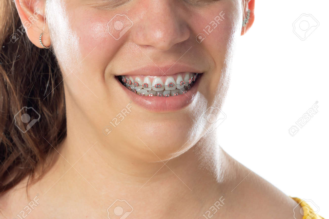Close-up portrait of cheerful woman isolated on a white background - 169707830