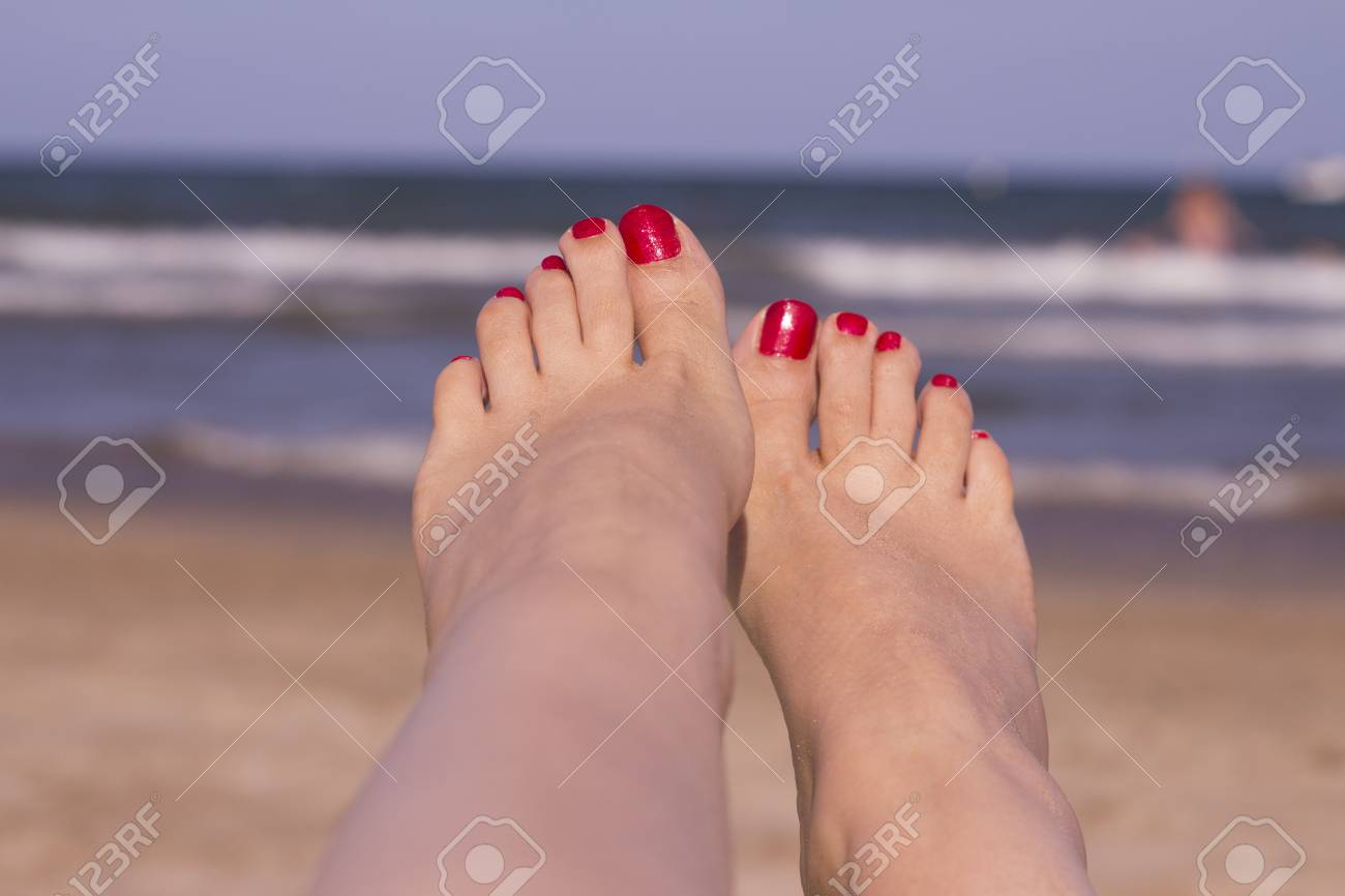 Beach Scene With Woman Feet On The Sand. Nails Of Feet Painted ...
