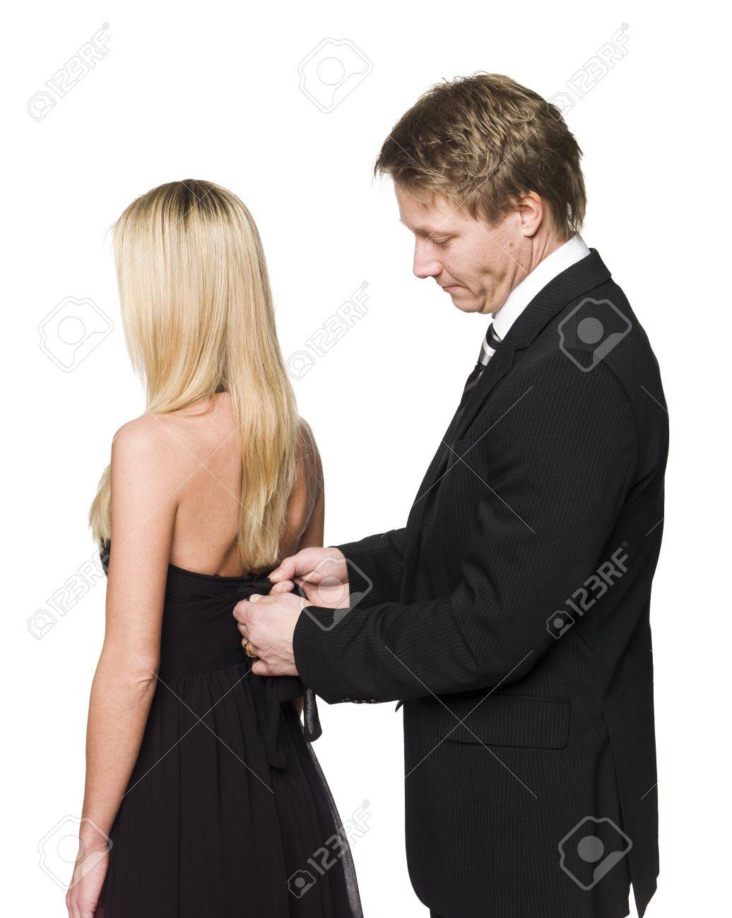 man helping woman to get dressed Stock Photo - 4397483