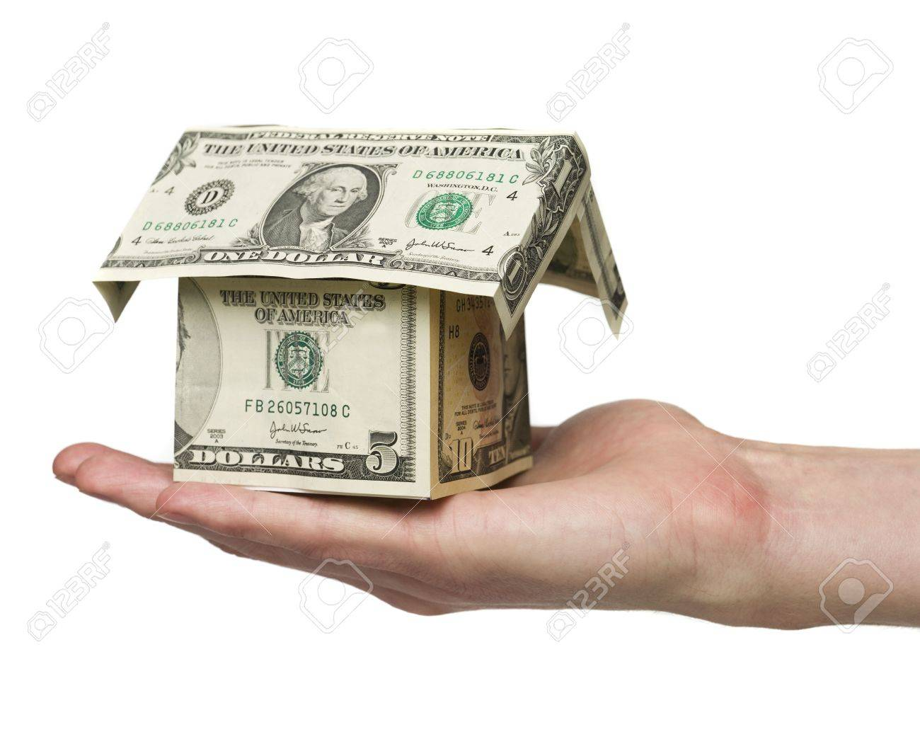 Man holding a small house built out of dollar bills Stock Photo - 5520837