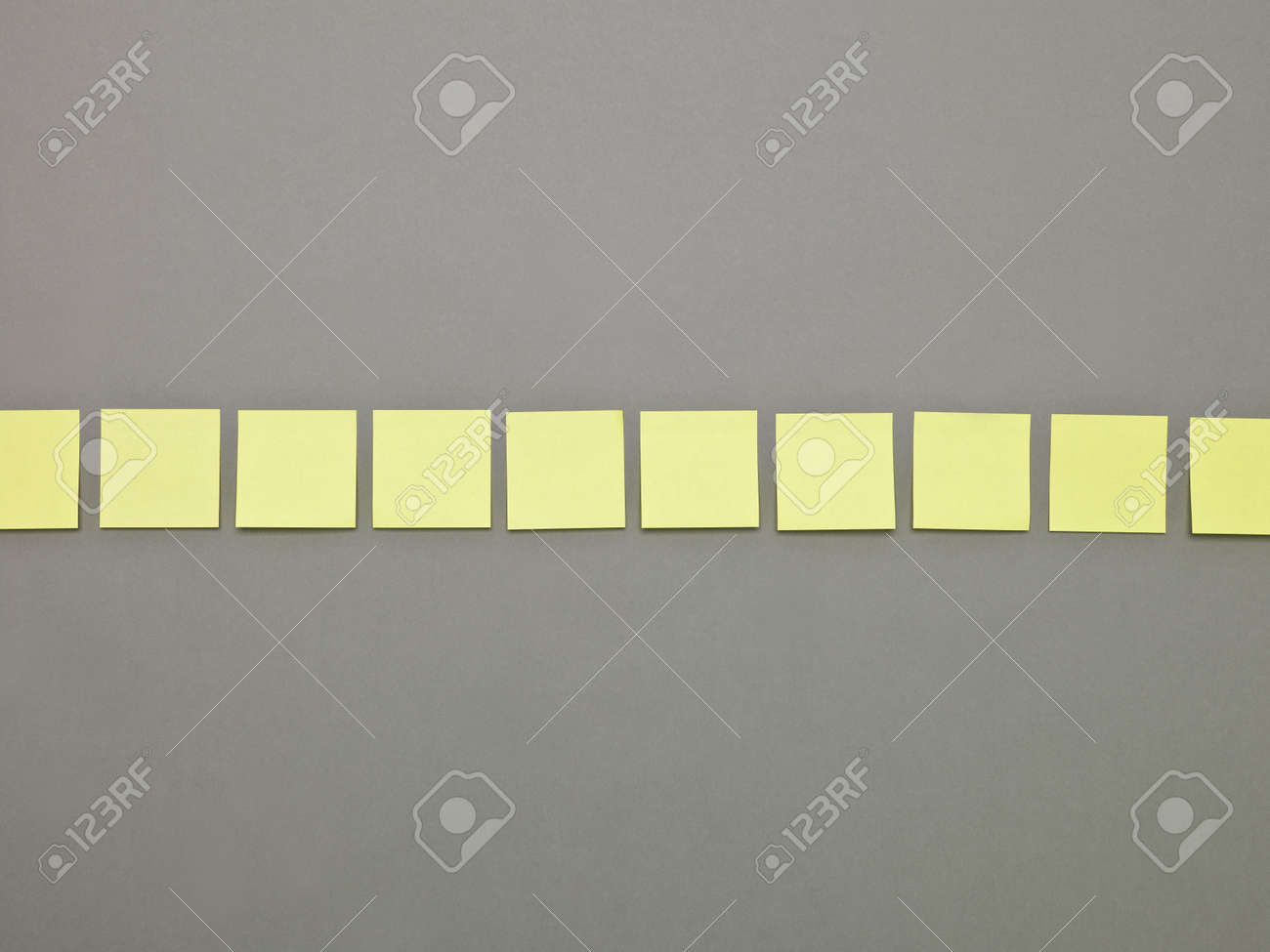Yellow Adhesive Notes in a row Stock Photo - 7039530