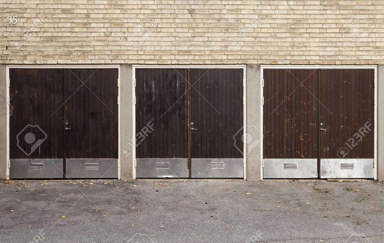 Three Worn Garage Doors outdoor Stock Photo - 8035536