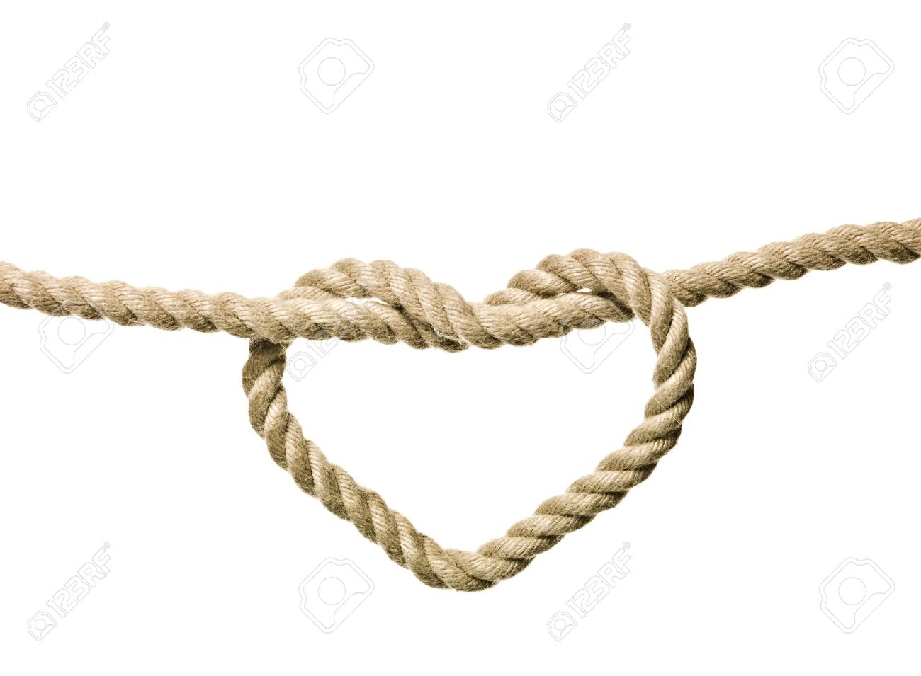 Heart Shaped Knot on a rope isolated Stock Photo - 8048876