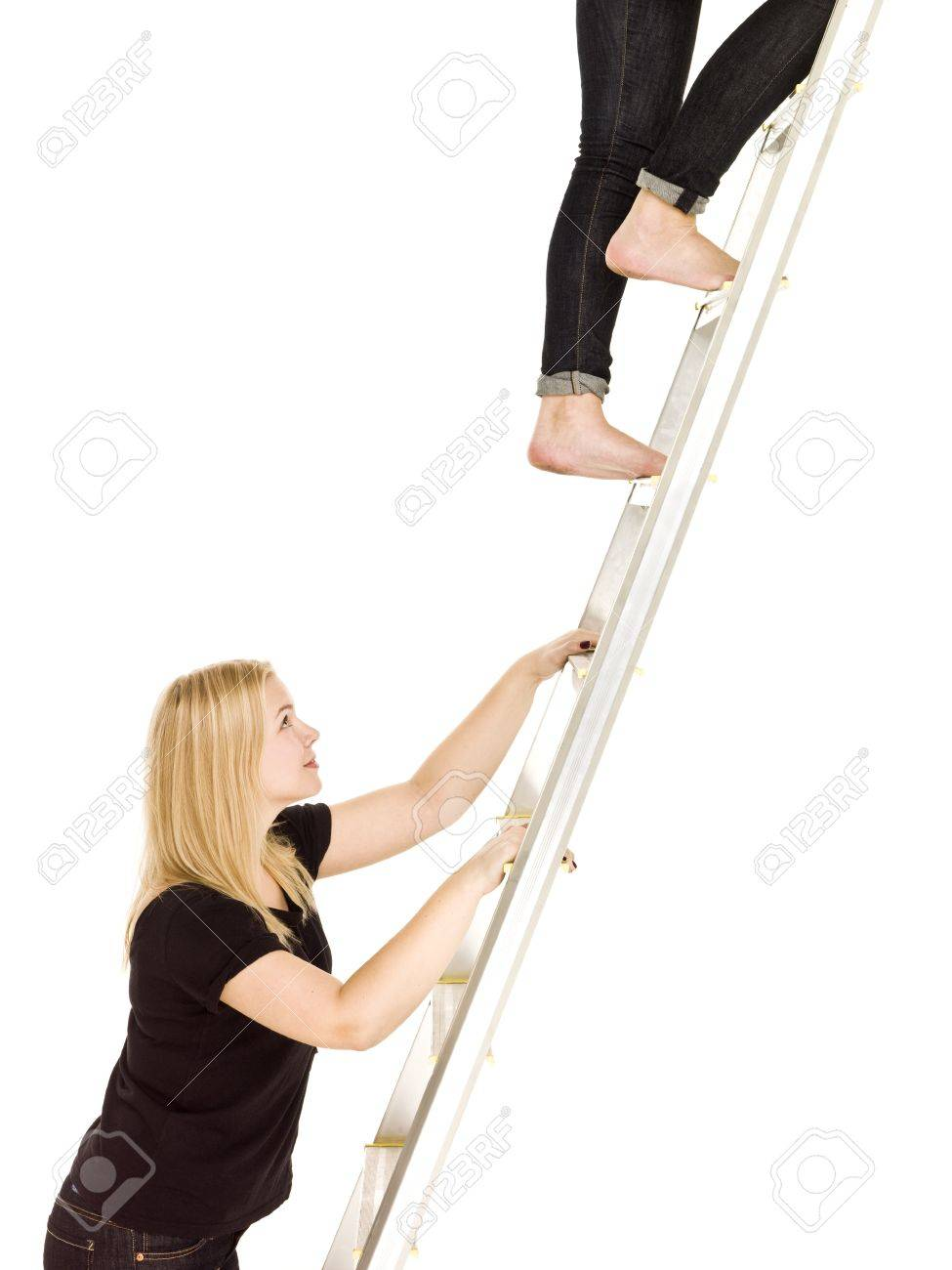 women climbing up the ladder isolated on white background stock stock photo women climbing up the ladder isolated on white background