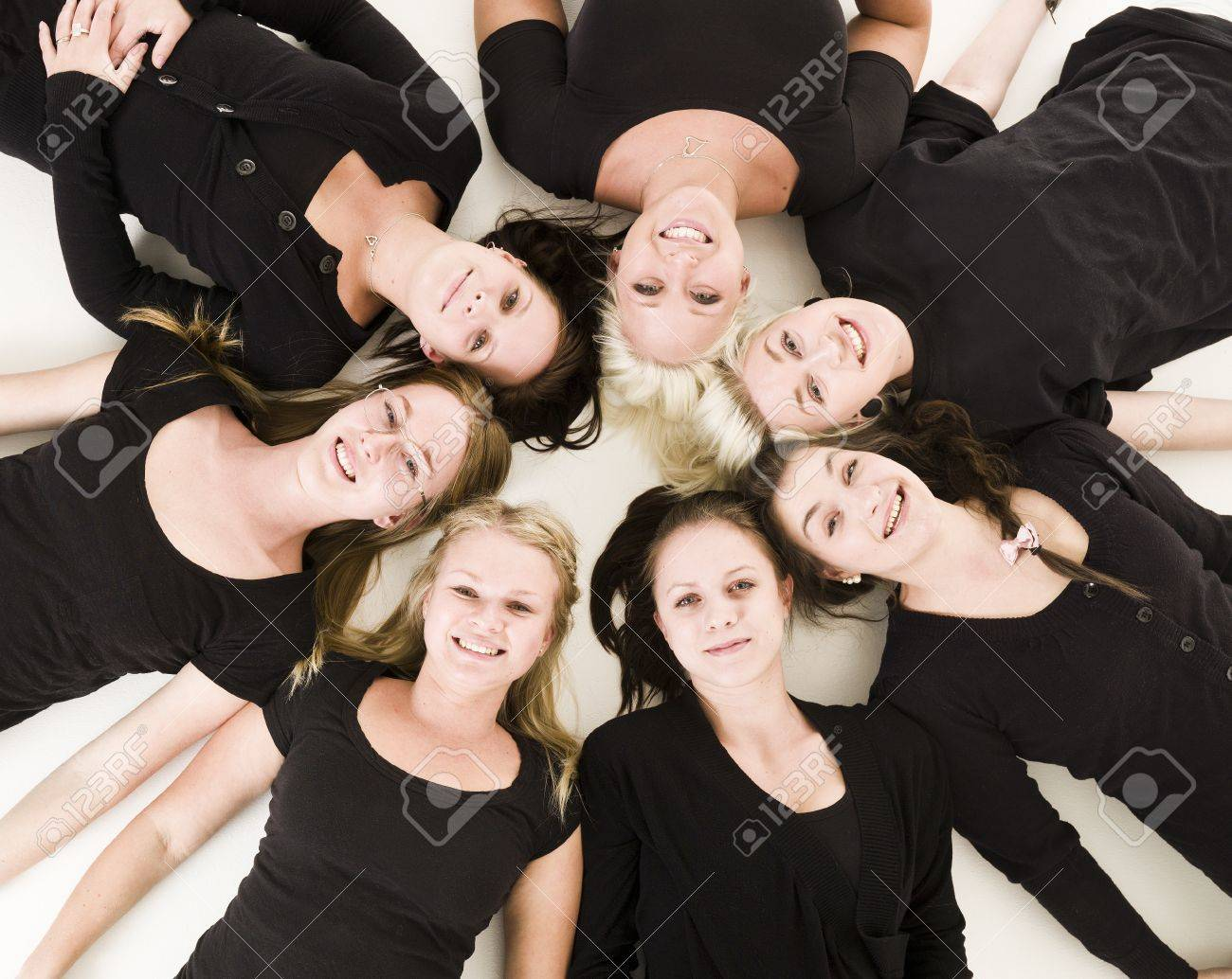 Group of Young Women lieing in a circle on white background Stock Photo - 9193976