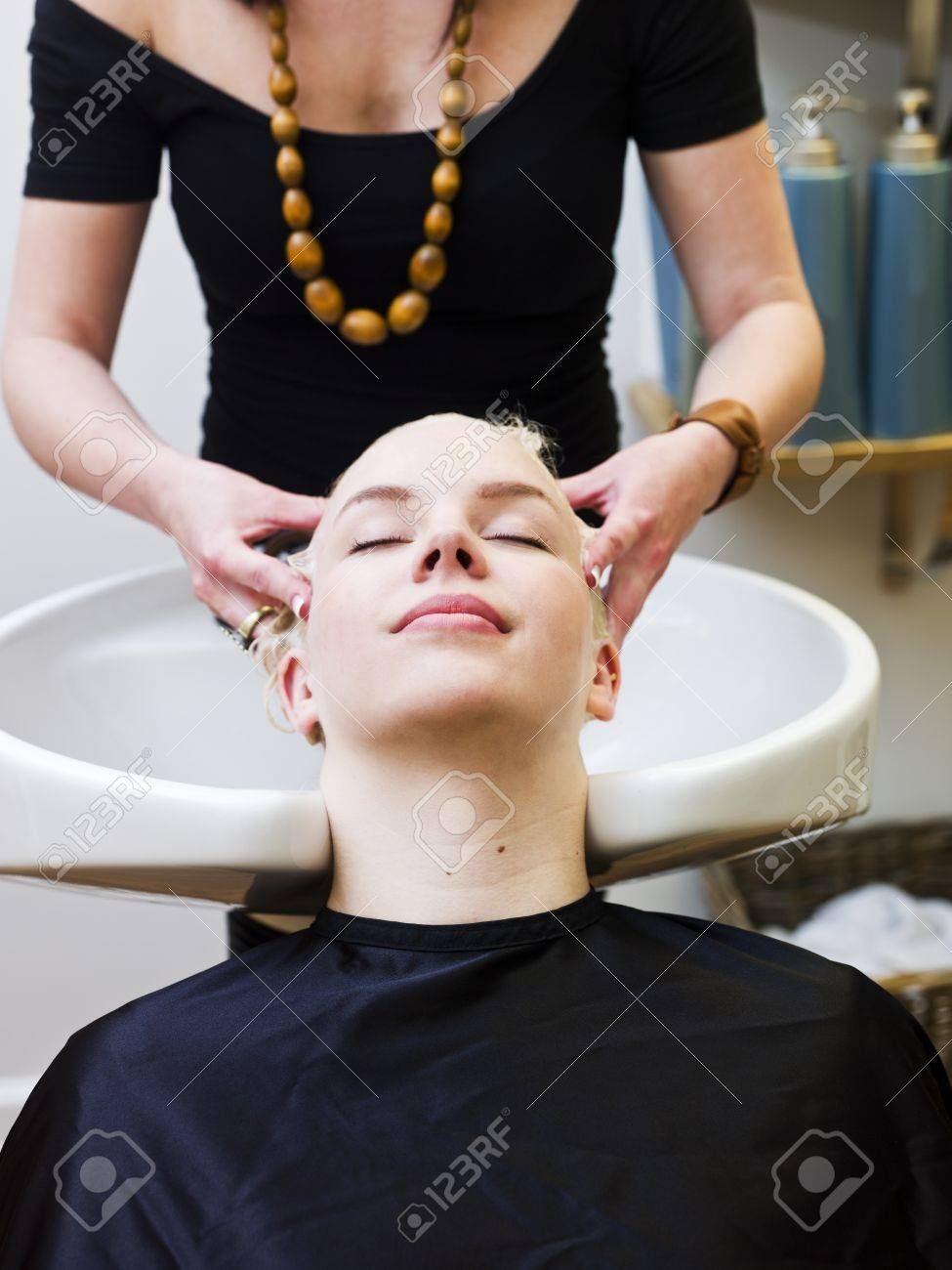 Hairdresser washing customers hair at a Beauty Spa Stock Photo - 9289020