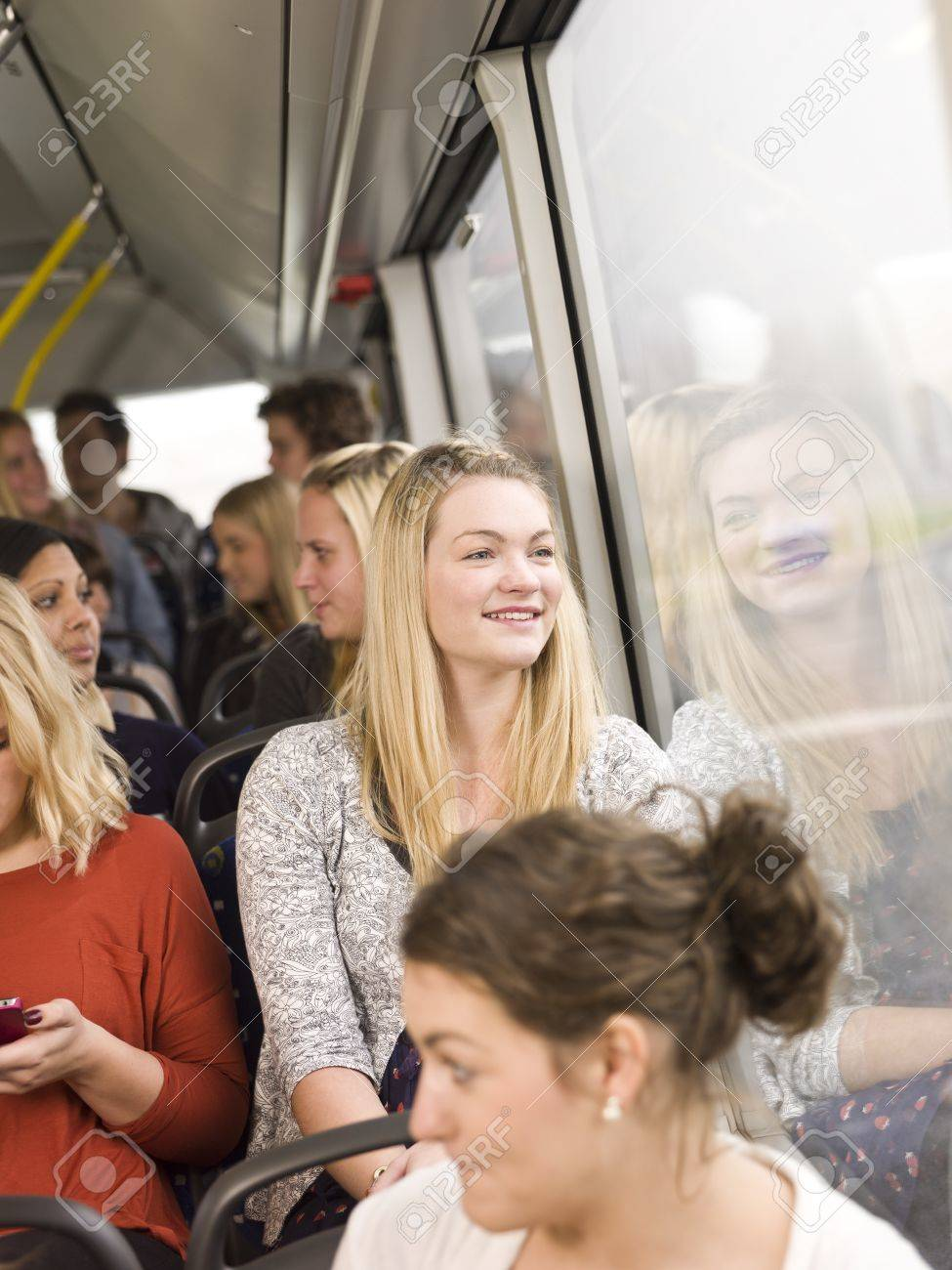 Happy woman on the bus - 11223926