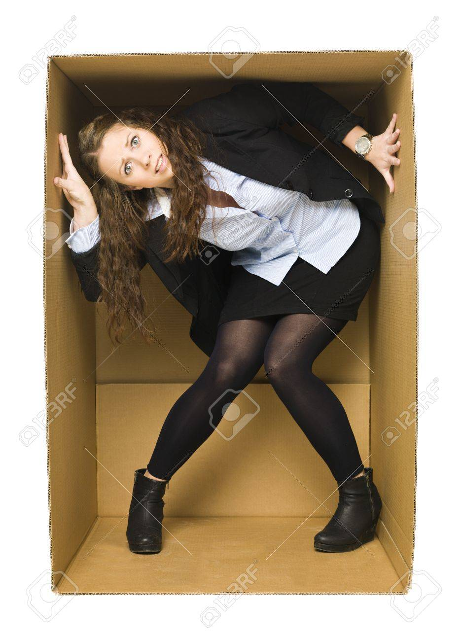 Young Woman inside of a tight Cardboard Box Stock Photo - 11741015