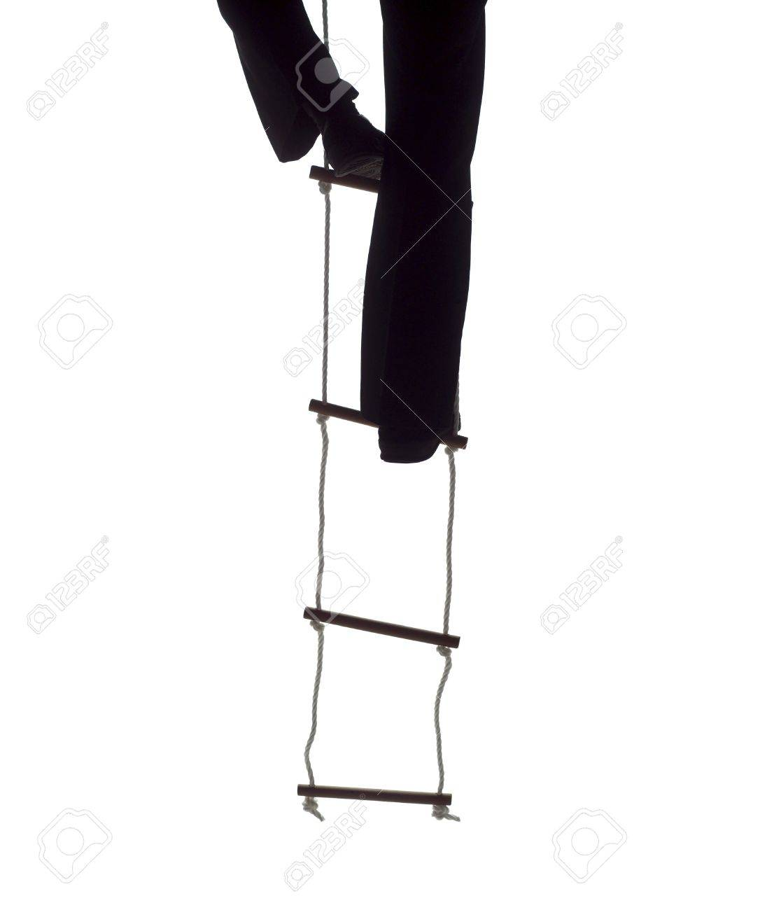 climbing up the rope ladder stock photo picture and royalty climbing up the rope ladder stock photo 12601243