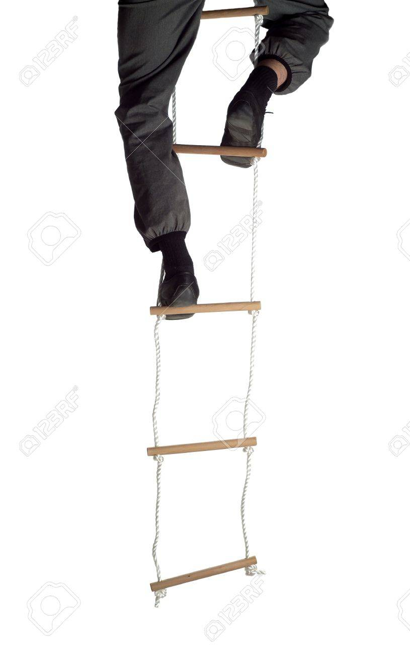 climbing up the rope ladder stock photo picture and royalty climbing up the rope ladder stock photo 12601204