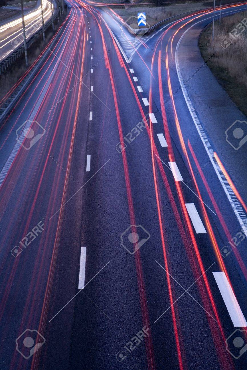 Highway with moving cars at dawn - 12844186