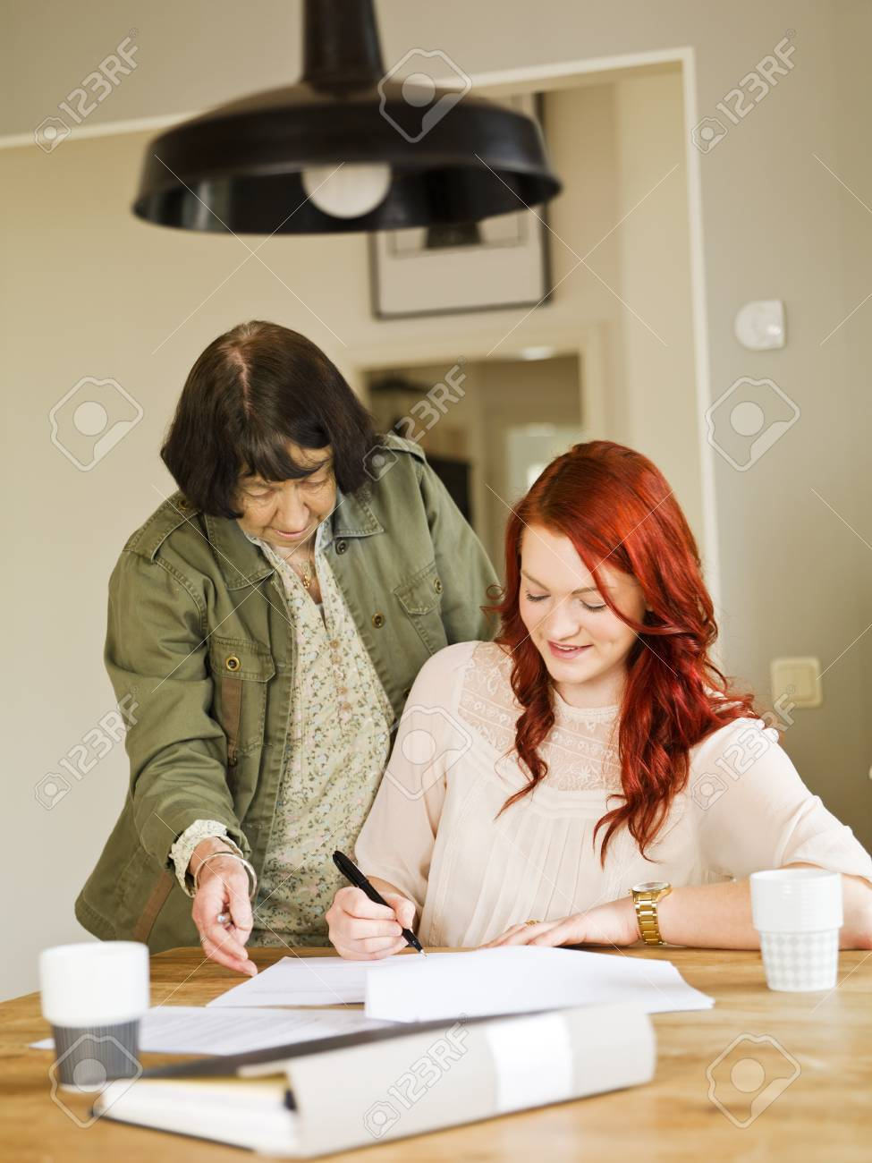 Grandmother helping her grandaughter with paperwork Stock Photo - 12899180