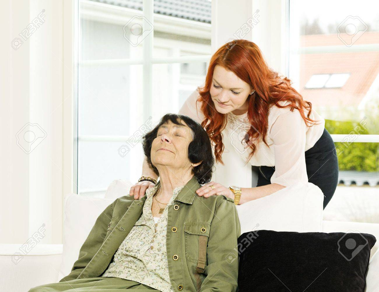 Young woman giving massage to her Grandmother Stock Photo - 12899186