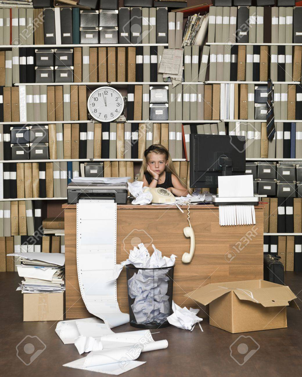 Tired Young Girl at a messy office Stock Photo - 14903369