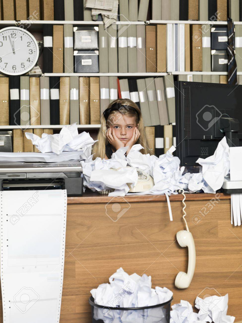 Sour young girl at the office Stock Photo - 14903399
