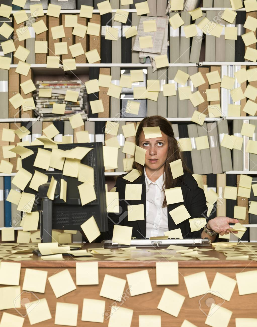 Businesswoman overloaded with reminding notes Stock Photo - 14903424